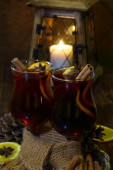 Mulled wine with an orange, honey, cinnamon, a carnation and an  — Stock Photo