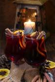 Mulled wine with addition of an orange, honey, cinnamon, a carna — Stock Photo