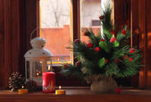 Small lamp, candles, cones and a decorative fur-tree — Stockfoto