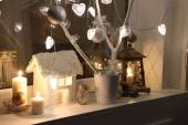 Candles, a decorative small house, fur-tree branches and a small — ストック写真