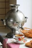 Tea with a lemon and cookies and a samovar — Stock Photo