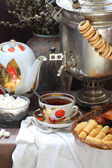 Tea with wafer tubules and a samovar — Stock Photo