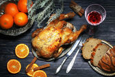 The hen a grill submitted with oranges, bread and red wine, a st — Stock Photo