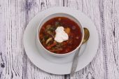 Vegetable borsch with a string bean submitted with sour cream — Stock Photo