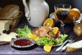 Chicken - kornishony and a red wine glass — Stock Photo