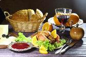 Chicken - kornishony and a red wine glass — Stok fotoğraf