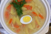 Chicken soup with house noodles and boiled egg  — Stock Photo