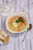 Chicken soup with noodles and egg — Stock Photo