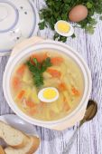 Chicken soup with egg and noodles submitted to a soup tureen — Stock Photo