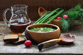 Jug with kvass and okroshka in a wooden bowl — Stock Photo