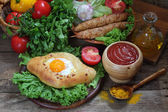 Open pie with egg and cutlets on a skewer submitted with sauce a — Stock Photo