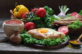 Still-life with a pie and ljulja-kebab submitted with fresh vege — Stock Photo