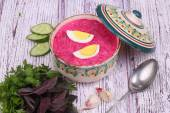 Beetroot soup - cold soup with a beet and egg submitted with gre — Stock Photo