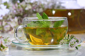 Tea from gathering of medicative herbs and mint in a transparen — Stock Photo