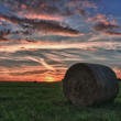 Hay bales on a meadow against beautiful sky with clouds in sunset in hdr photo — Stockfoto #57932927