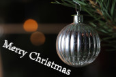 Christmas bauble on tree with text Merry Christmas  — Stock Photo