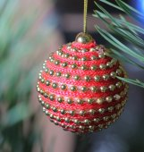 Red christmas bauble on tree  — Stock Photo