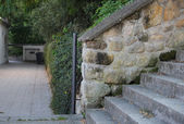 Wall from big stones and stairs in park — Stock Photo