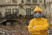 Man with protective  mask and protective  clothes  explores danger area — Photo