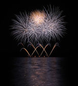 Colorful fireworks with reflection on lake. — Stock Photo