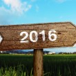 Year 2016 wooden road sign — Stock Photo #68755395