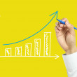 Businessman hand drawing growth graph — Stock Photo #70386883