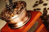 Closeup coffee bean and coffee grinder — Stock Photo