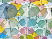 Multicolored umbrellas in pastel style. — Stock Photo