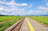 Railroad and yellow line on platform — Stock Photo