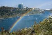 Rainbow with rainbow bridge — Stock Photo