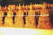 Line up of image of Buddha — Stock Photo
