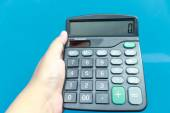 Woman's hands with a calculator — Foto de Stock