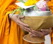 Giving alms to monks receive alms — Stock Photo