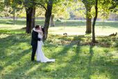 Elegant bride and groom posing together outdoors — Stock Photo