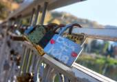 Names on the padlocks as a proof of love — Stock Photo