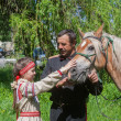 Makeevka, Ukraine - May, 7, 2014: Male cossack and a girl in nat — Stock Photo #66756633