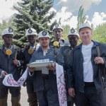 Donetsk, Ukraine - 26 July, 2013: Miners with coal symbolic ingo — Stock Photo #73707939