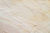 Patterned sandstone texture background (natural color). — Stock Photo