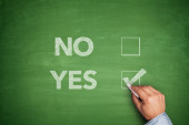 Yes or No, two choices written on blackboard — Stock Photo