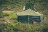 Green military tent — Stock Photo