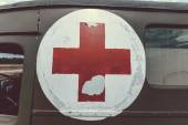 Red cross on army ambulance — Stock Photo