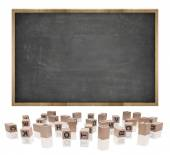 Black blank blackboard with wooden frame and block letters — Stock Photo