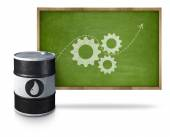 Oil barrel with gear icons on blackboard with wooden frame — Stock Photo