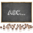 ABC concept on blackboard with wooden frame and block letters — Stock Photo #76518177