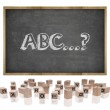 ABC concept on blackboard with wooden frame and block letters — Stock Photo #76707901