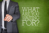 What are you waiting on on blackboard with businessman — Stock Photo