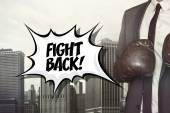 Fight back text with businessman wearing boxing gloves — Stock Photo