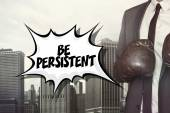 Be persistent text with businessman wearing boxing gloves — Stock Photo