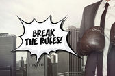 Break the rules text with businessman wearing boxing gloves — Stock Photo