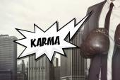 Karma text with businessman wearing boxing gloves — Stock Photo